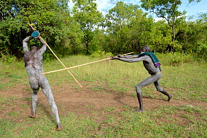 'Donga' stick fighters, Suri / Surma tribe. The Donga fights are an outlet to resolve conflicts between tribes. Omo river Valley, Ethiopia, September 2014. - Eric Baccega