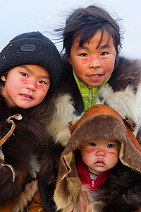 Chukchi girls, with their family's ancestral clan mark painted in reindeer blood on their face, a ritual during the Chukchi 'Festival of the Young Reindeer' during which young reindeer are sacrificed.... - Bryan and Cherry Alexander