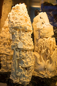Carved ivory tusks, for sale in shop on Nathan Road, Kowloon, Hong Kong, December 2012.  -  Steve O. Taylor (GHF)