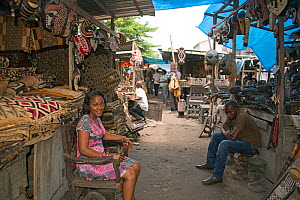 Woman selling rugs at Matche de la Volier (Market of the Thieves), Kinshasa, Democratic Republic of the Congo, March 2012.  -  Steve O. Taylor (GHF)