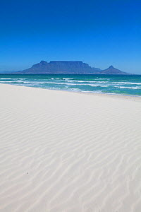 Pristine white beach with table mountain beyond under a clear blue sky. Bloubergstrand, Cape Town, South Africa. November 2011. - Hougaard Malan