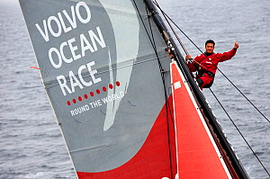 Jin Hao Chen up the sail of the Donfeng Race Team, Volvo Ocean Race 2014, August. All non-editorial uses must be cleared individually. - Benoit  Stichelbaut