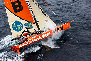 Side view of the IMOCA 60 'PRB' preparing for the start of the Route du Rhum, 10th October 2014. Skipper, Vincent Riou. All non-editorial uses must be cleared individually. - Benoit  Stichelbaut