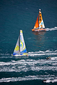 IMOCA Open 60 'PRB' (Skipper, Vincent Riou) and 'Macif' (Skipper, Francois Gabart) at the start of the Route du Rhum, departing from Saint-Malo 2nd November 2014. All non-editorial uses must be cleare... - Benoit  Stichelbaut