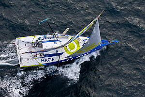 Aerial view of the IMOCA Open 60 'Macif' at the start of the Route du Rhum, departing from Saint-Malo 2nd November 2014. Skipper, Francois Gabart. All non-editorial uses must be cleared individually. - Benoit  Stichelbaut