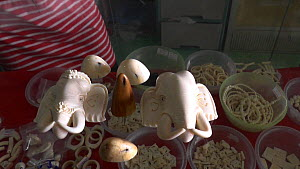 Asia,South East Asia,Thailand,Moving Image,Footage,Handheld,Building,Store,Shop,Shops,Stores,Ivory ,Conservation,Wildlife trade,Ivory,Conservation issues,Animal trade,HD,High definition,Ivory object - Products made of elephant ivory, including elephant head statuet