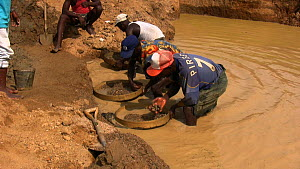 People,African Descent,Man,Group,Medium Group,Group Of People,Africa,West Africa,Sierra Leone,Moving Image,Footage,Sound,Handheld,Panning,Equipment,Jewel,Diamond,Diamonds,Flowing Water,Outdoors,Indust... - Miners panning for diamonds in a pool, Kono District, Sierra Leo