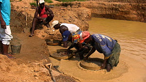 People,African Descent,Man,Group,Medium Group,Group Of People,Africa,West Africa,Sierra Leone,Moving Image,Footage,Sound,Equipment,Jewel,Diamond,Diamonds,Flowing Water,Stream,Streams,Outdoors,Industry... - Miners panning for diamonds in a pool, Kono District, Sierra Leo