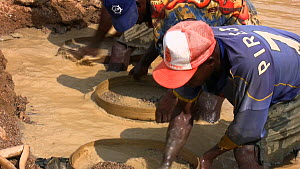 People,African Descent,Man,Few,Three,Group,Group Of People,Africa,West Africa,Sierra Leone,Moving Image,Footage,Sound,Close Up,Zoom Out,Equipment,Jewel,Diamond,Diamonds,Flowing Water,Stream,Streams,Ou... - Miners panning for diamonds in a pool, Kono District, Sierra Leo