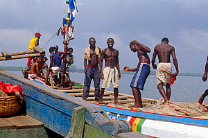 Local cargo and passenger vessel with crew, Port Loko, Sierra Leone, 2004-2005. - Steve O. Taylor (GHF)