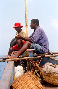 Man with shell to blow to announce departure and arrival on boat journey to Bunce island. Sierra Leone, 2004-2005. - Steve O. Taylor (GHF)