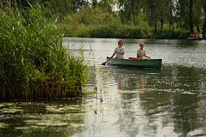 Tourists canoeing on the Peene river, Anklam, Germany, August 2014. - Wild  Wonders of Europe / Zankl