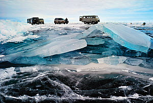 Vehicles parked on ice on the surface of Lake Baikal, Siberia, Russia, March 2008.  -  Olga Kamenskaya
