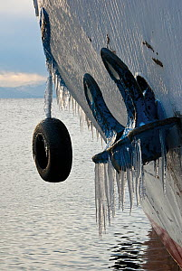 Boat hull with icicles. Lake Baikal, Siberia, Russia, December 2008. - Olga Kamenskaya