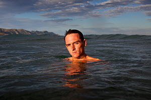 William Trubridge, a world champion free diver who is campaigning to protect the Critically Endangered Maui's dolphin (Cephalorhynchus hectori maui) endemic to New Zealand. December 2012.  Editorial u... - Richard Robinson