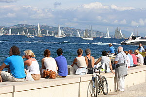The crowds enjoying the racing on the harbour wall, Les Voiles De St Tropez regatta, St Tropez, France, October 2013. All non-editorial uses must be cleared individually. - Ingrid  Abery