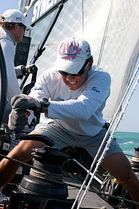 Crew member grinding / winching aboard R44 yacht Synergy, racing at Key West, Florida, January 2011 All non-editorial uses must be cleared individually. - Ingrid  Abery