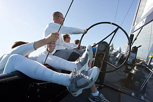 Crew trapezing whilst one man helms the R44 yacht 'Synergy', racing at Key West, Florida, January 2011 All non-editorial uses must be cleared individually. - Ingrid  Abery