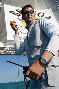 Man with stopwatch and walkie talkie aboard R44 yacht Synergy, racing at Key West, Florida, January 2011 All non-editorial uses must be cleared individually. - Ingrid  Abery