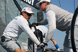 Crewmen grinding / winching aboard 'Synergy' yacht racing at Key West, Florida, USA. December 2013. All non-editorial uses must be cleared individually. - Ingrid  Abery