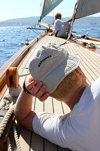 Crew resting on the 1911 Classic yacht Mariquita, day one of Les voiles de St Tropez, St Tropez, southern France, September 2011 All non-editorial uses must be cleared individually. - Ingrid  Abery