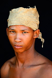 Portrait of Naro San Bushman with leather headdress made of duiker skin, Kalahari, Ghanzi region, Botswana, Africa. October 2014. - Eric Baccega