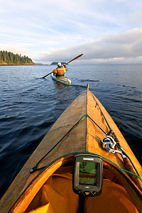 View from kayak as Phil Russell leads the way to fishing grounds along the Strait of Juan De Fuca, Washington, USA, August 2014. Model released. - Kirkendall-Spring