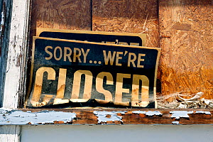 'Closed' sign in boarded up shop window, Sprauge, Washington, USA, June 2014.  -  Kirkendall-Spring