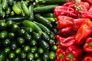 Vegetables, red peppers and courgettes at market at Aix en Provence, France, October. - David Noton
