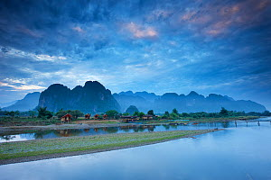 Dawn over the mountains and Nam Song River at Vang Vieng, Laos, March 2009.  -  David Noton