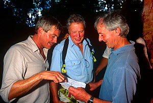Sir David Attenborough, series producer Mike Salisbury and sound recordist Trevor Gosling on location for BBC Private Life of Plants (1995). Sir David is about to climb a tree, Costa Rica.  -  Michael Pitts