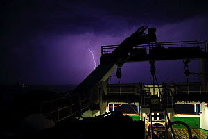 View of lightning from a fishing vessel on the North Sea, May 2014. All non-editorial uses must be cleared individually.  -  Philip  Stephen