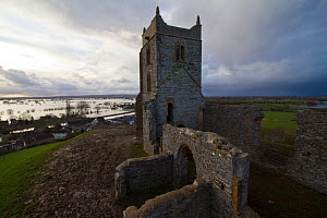 Burrow Mump, a small hill on top of which is the ruined 18th century church of St Michaels, with views over the flooded Somerset levels. Near Burrowbridge, Somerset, UK, February 2014. - John Waters
