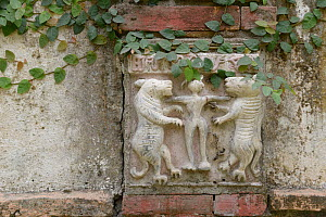Ornamental carving in wall showing Tigers and human figure, Assam, India.  -  Loic  Poidevin