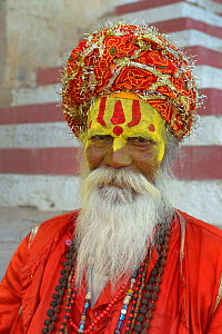 Portrait of priest with painted face wearing turban, Varanasi, Uttah Pradesh, India, March 2014l.  -  Loic  Poidevin