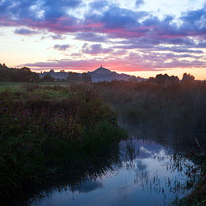 River Brue, at dawn with Glastonbury Tor in background,  Somerset, UK, August. Digital composite. - John Waters