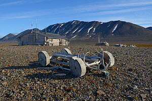 Wooden cart used to transport seals outside hut of trapper. Spitzberg, Svalbard, Norway, August 2014.  -  Loic  Poidevin