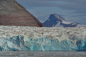 Glacier with mountain beyond, Spitzberg, Svalbard, Norway, August 2014.  -  Loic  Poidevin