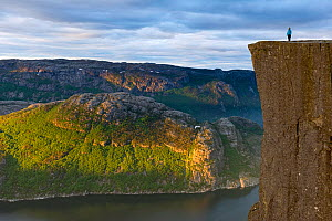 Person standing on The Preikestolen (Pulpit rock) at the Lysefjorden. Forsand, Rogaland, Norway, June 2012.  -  Erlend  Haarberg