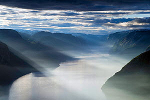 Lysefjorden viewed from the Preikestolen (Pulpit rock) on misty summer morning with sun rays shining down, Forsand, Rogaland, Norway. - Erlend Haarberg