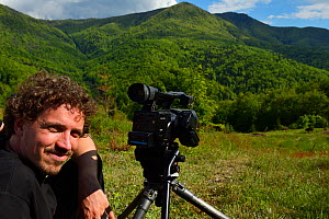 Kristjan Jung, Communications Manager at Rewilding Europe, filming European bison / Wisent (Bison bonasus) released into the Tarcu mountains nature reserve, Natura 2000 area, Southern Carpathians, Rom...  -  Wild  Wonders of Europe / Widstrand