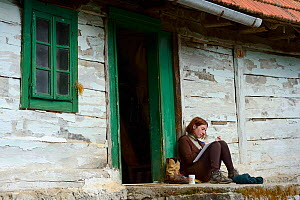 Woman sat writing outside Linden Tree Retreat & Ranch, Velika Plana, Velebit Mountains Nature Park, Croatia, April 2014.  -  Wild  Wonders of Europe / Widstrand
