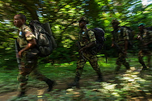 Eco-guards from African Parks on patrol. Mbomo, Odzala-Kokoua National Park, Republic of Congo (Congo-Brazzaville), June 2013. - Pete Oxford