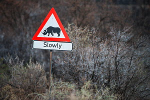 Rhino Traffic Sign on private game ranch. Great Karoo, South Africa, Septembe 2013.  -  Pete Oxford