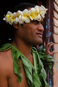Man wearing traditional floral headdress and leaves for ceremony, Kioa Island, Fiji, South Pacific, July 2014. - Pete Oxford