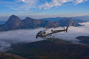 Aerial view of  Mount Namuli with helicopter with ciniflex flying in front, Mozambique, May 2011.  -  Hugh Pearson