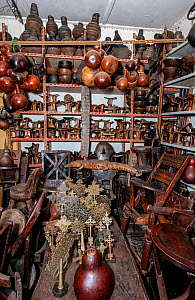 Interior of a toursit shop in Addis Ababa featuring various items such as Coptic crosses, headrests, bottle gourds, wooden chairs, a stuffed crocodile and various wood carvings, which the seller claim...  -  Constantinos Petrinos