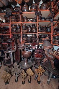 Interior of a toursit shop in Addis Ababa featuring various items such as Coptic crosses, headrests wooden chairs, wooden bowls and various wood carvings which the seller claimed to be antique. Addis...  -  Constantinos Petrinos