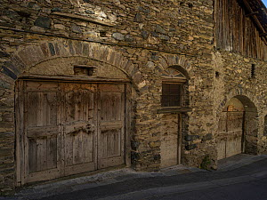 Stone building with wooden doors, typical of the area. Queyras, Hautes-Alpes, France, October 2014.  -  Pascal  Tordeux