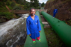 Technicians inspecting pipes carrying water to hydro electric power plant, Rwanda, September 2014.  -  Tom  Gilks